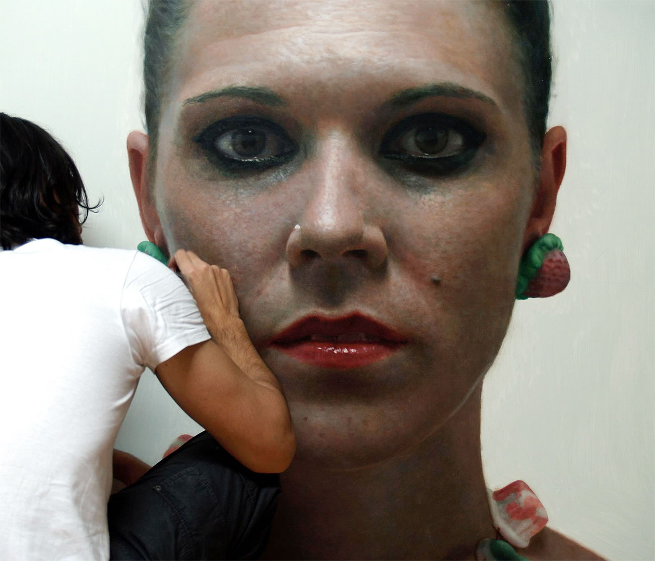 Eloy Morales painting a woman portrait