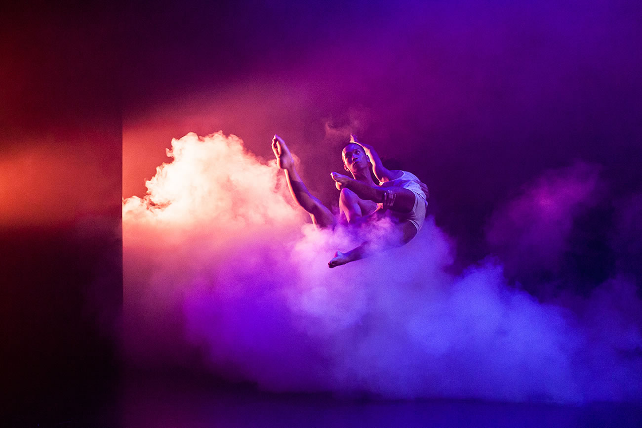 dancers, pink and purple background with smoke, photography by Lynn Lane