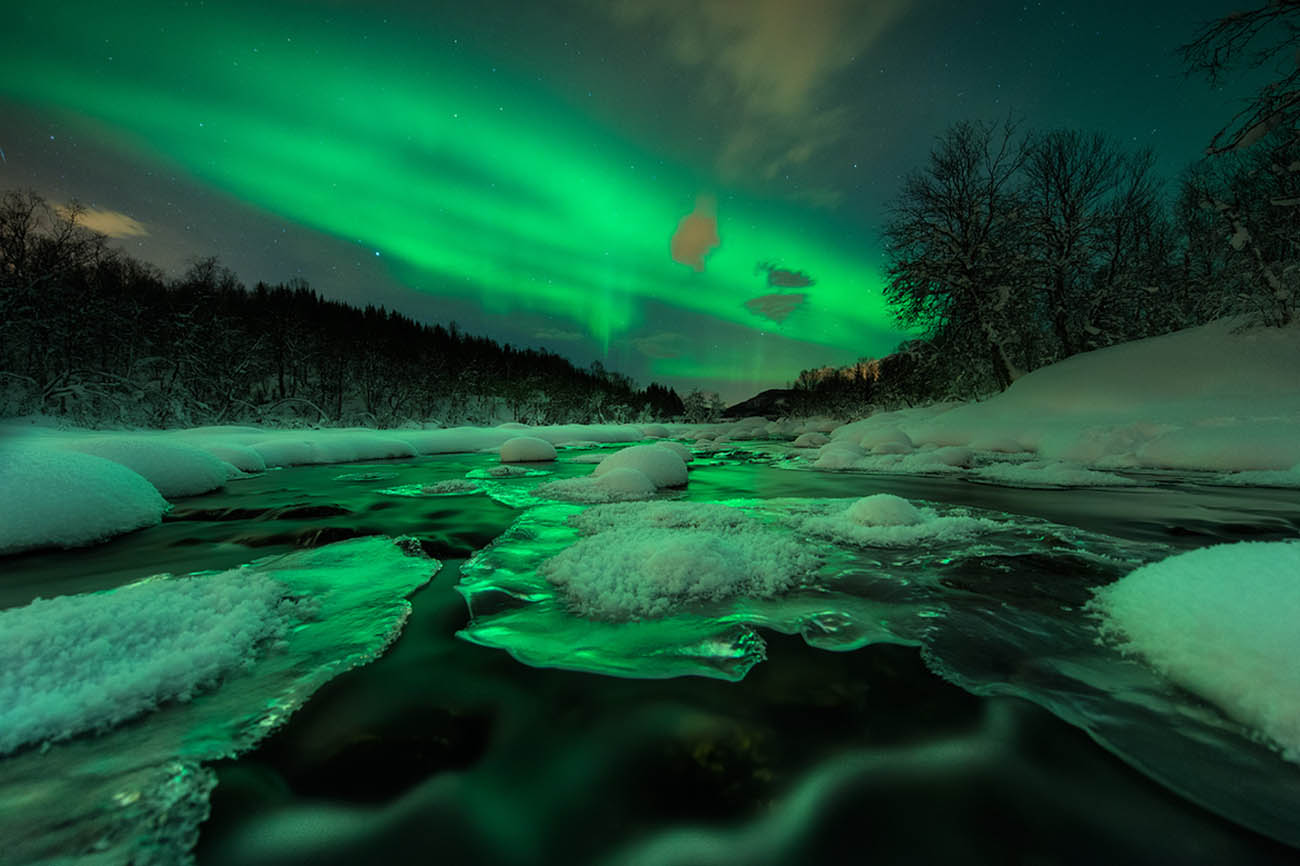 arild heitmann northern lights green landscape