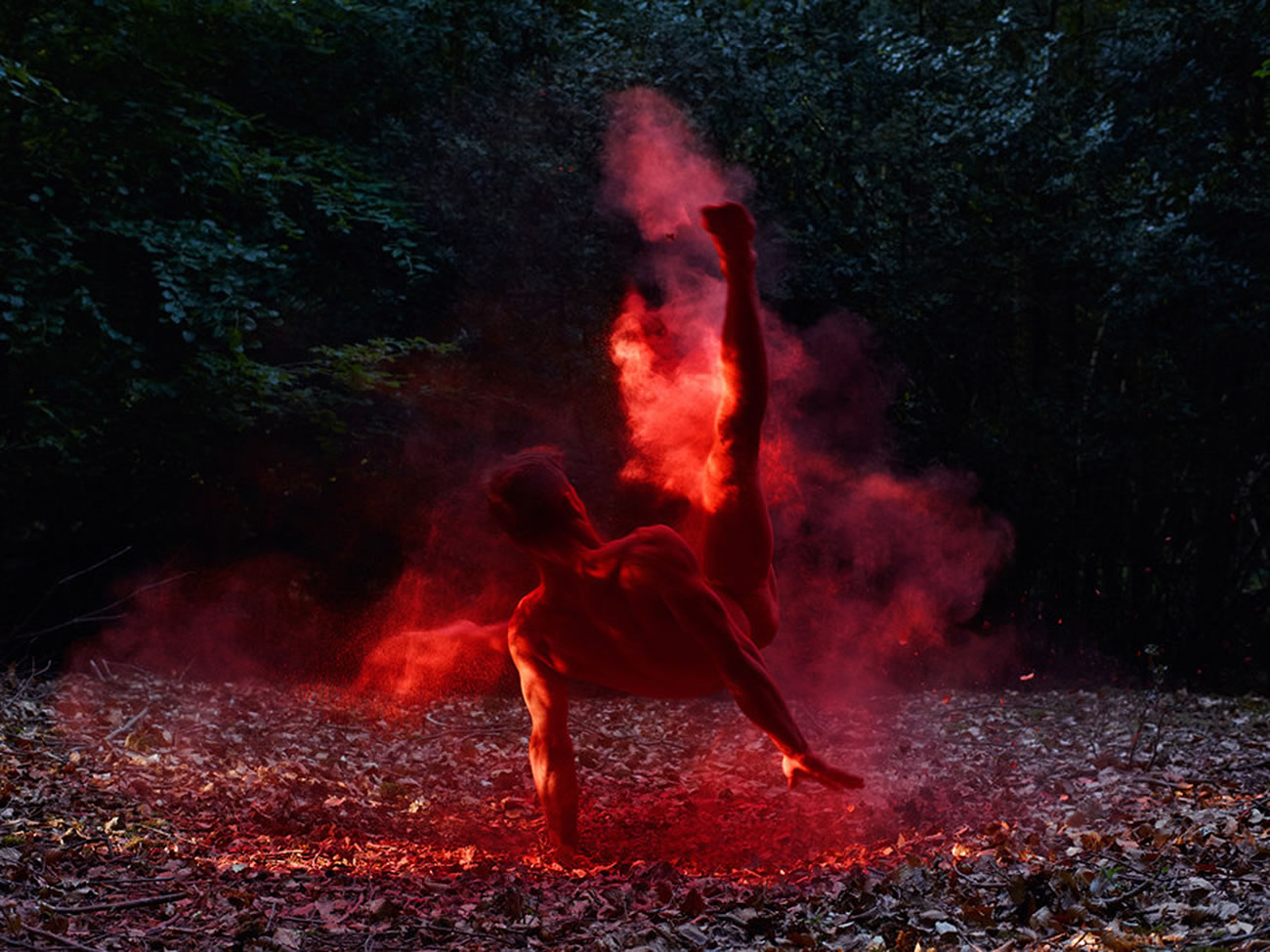 red dust on acrobatic man, photo by by bertil nilsson