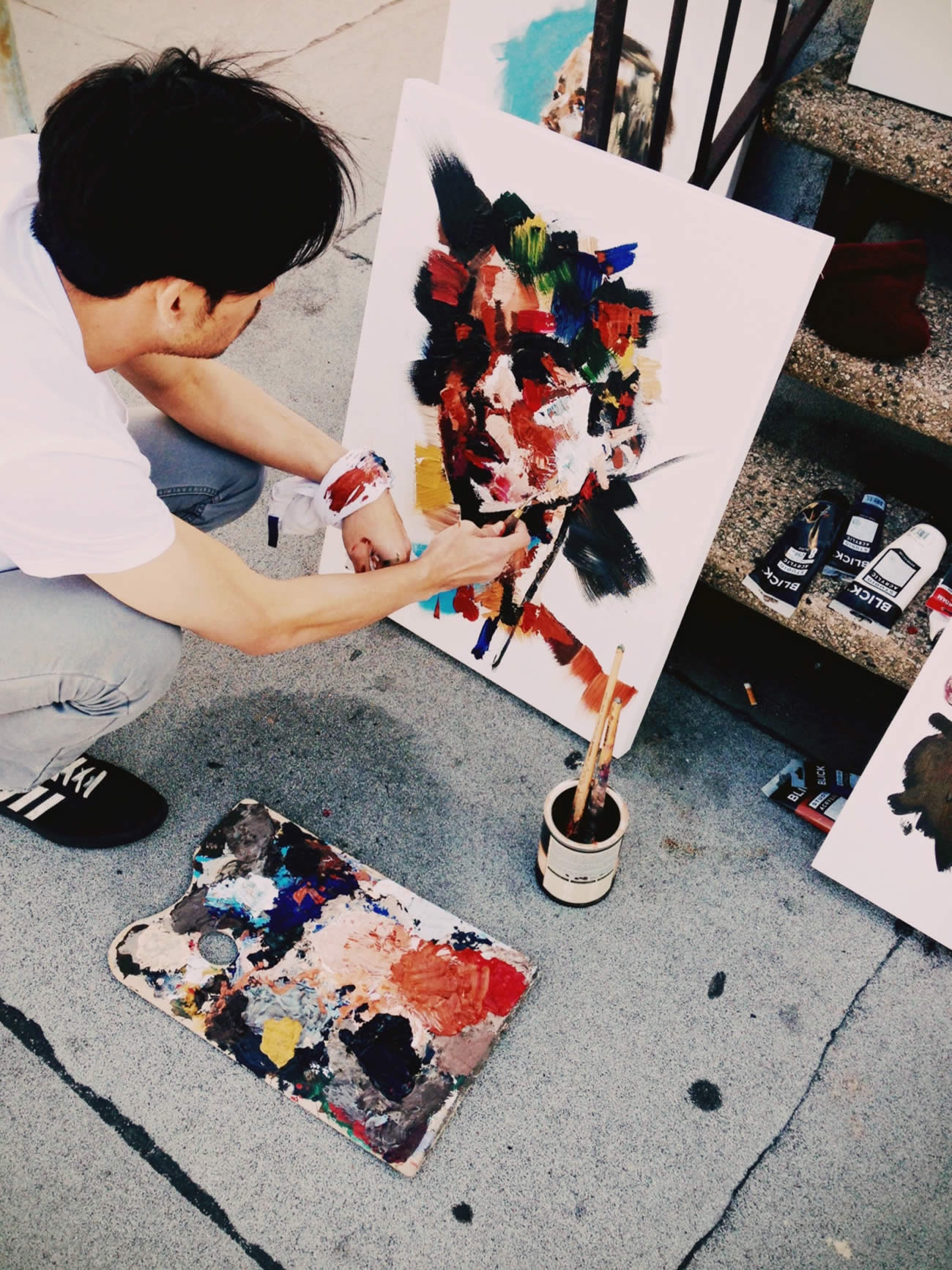 Joseph lee working on a portrait painting