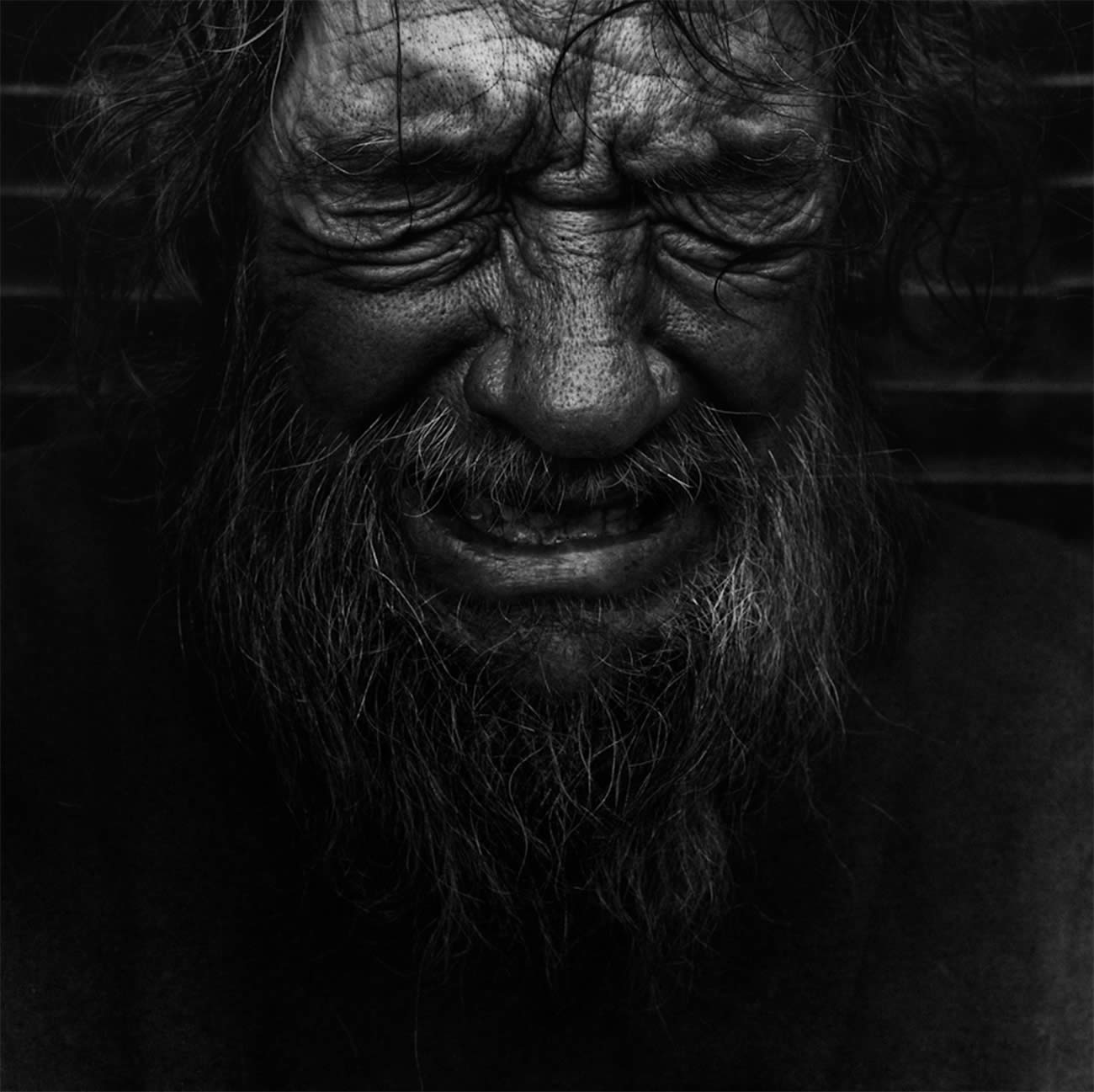 man suffering, crying, street photography by lee jeffries