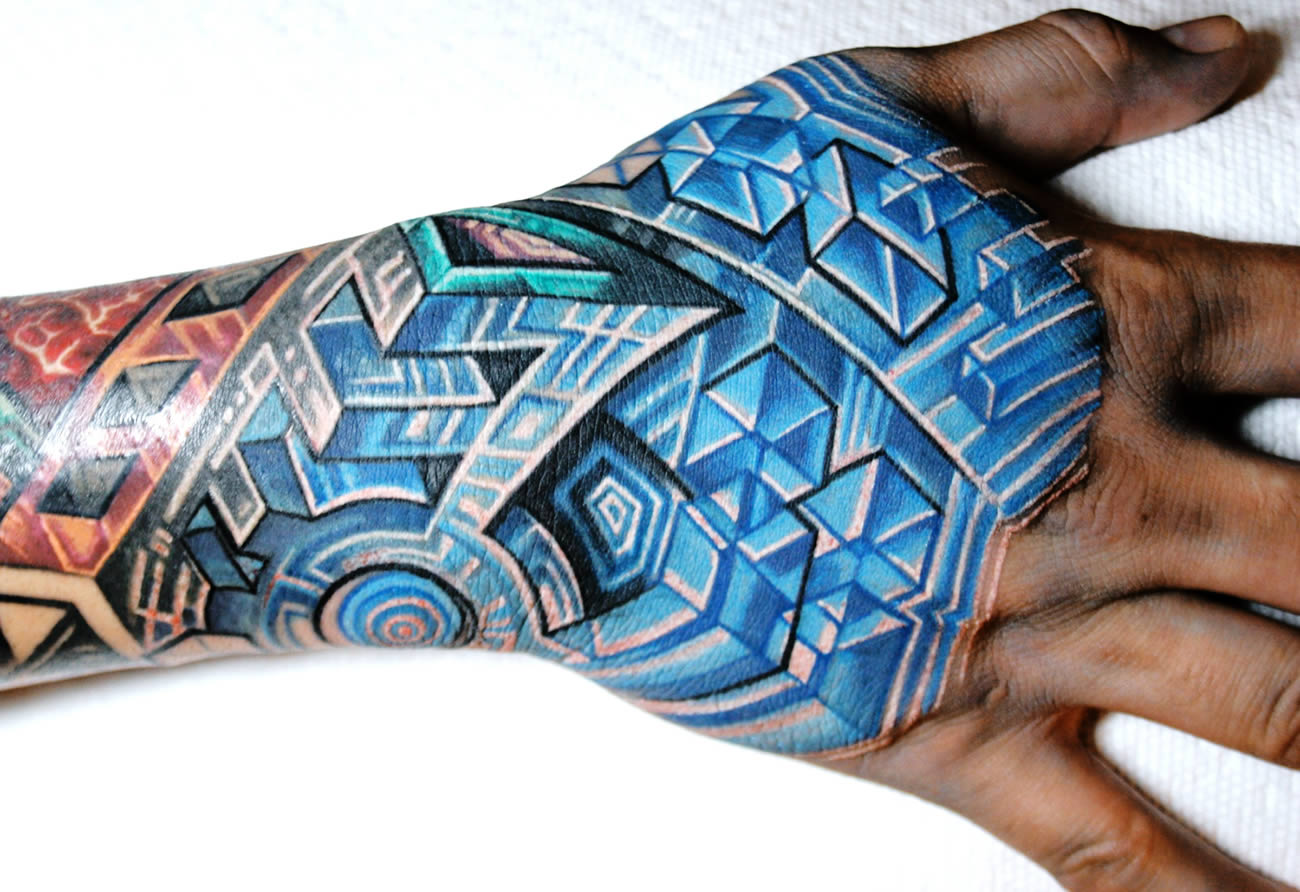hand tattoo in blue by mike cole