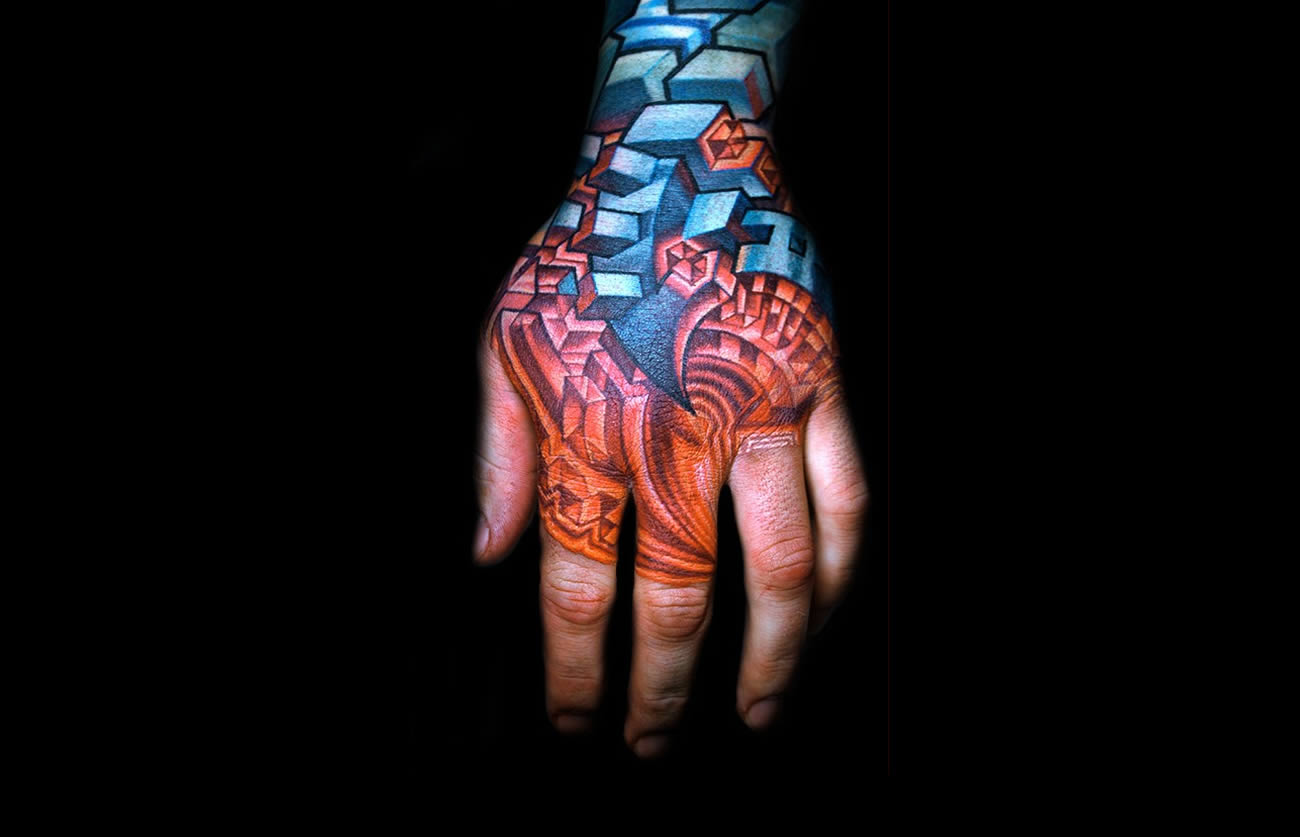 tattooed hand with 3d shapes by mike cole