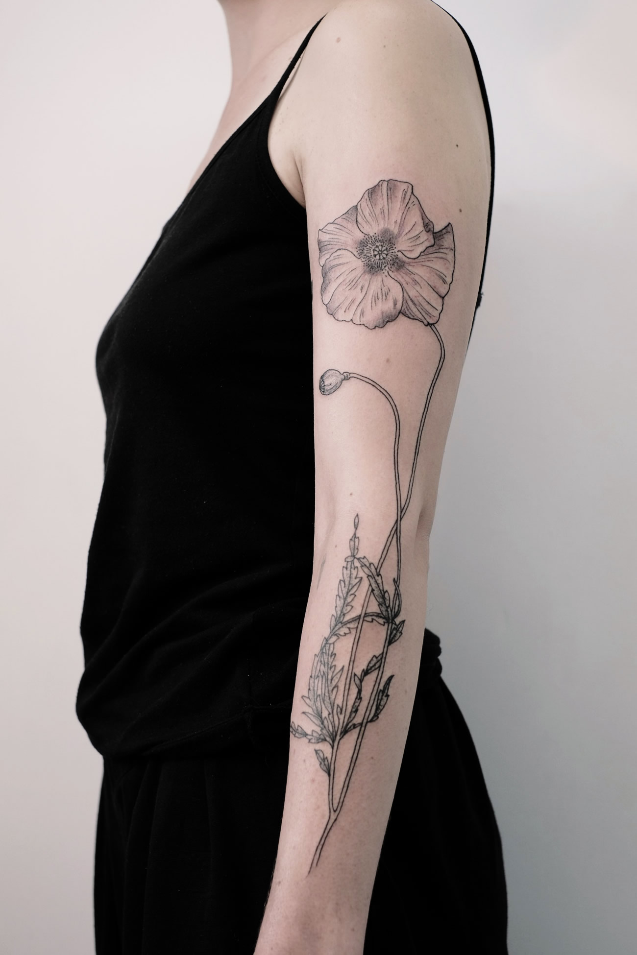 engraving style flower on arm by victor j webster