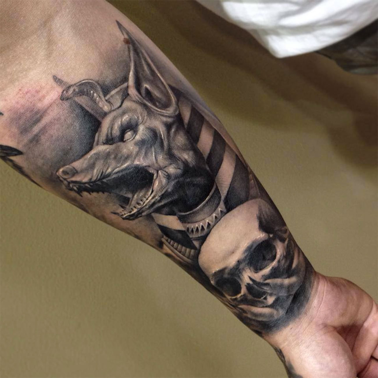 dog and skull tattoo on arm by Benjamin Laukis