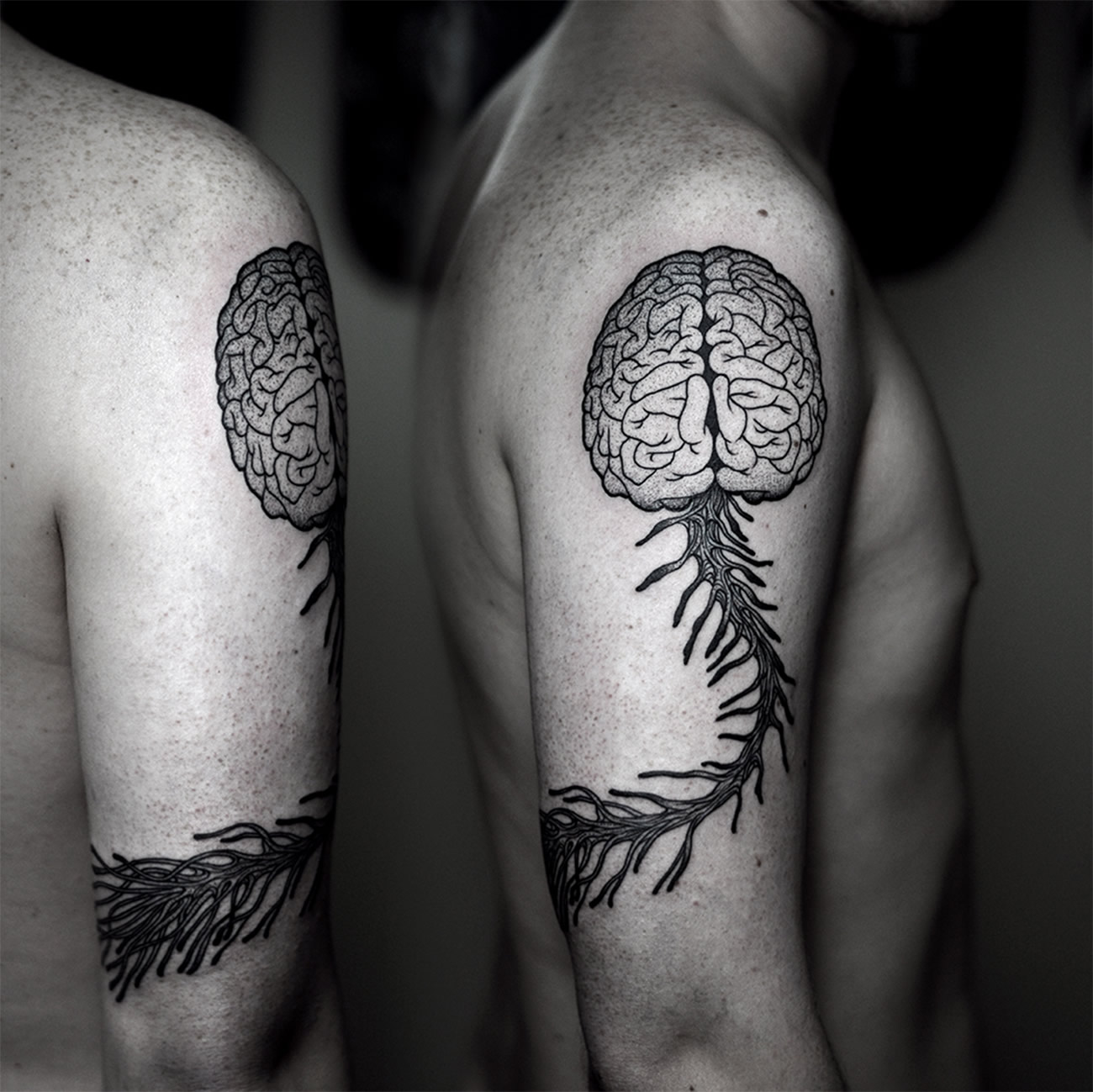 brain and spine tattoo by Kamil Czapiga