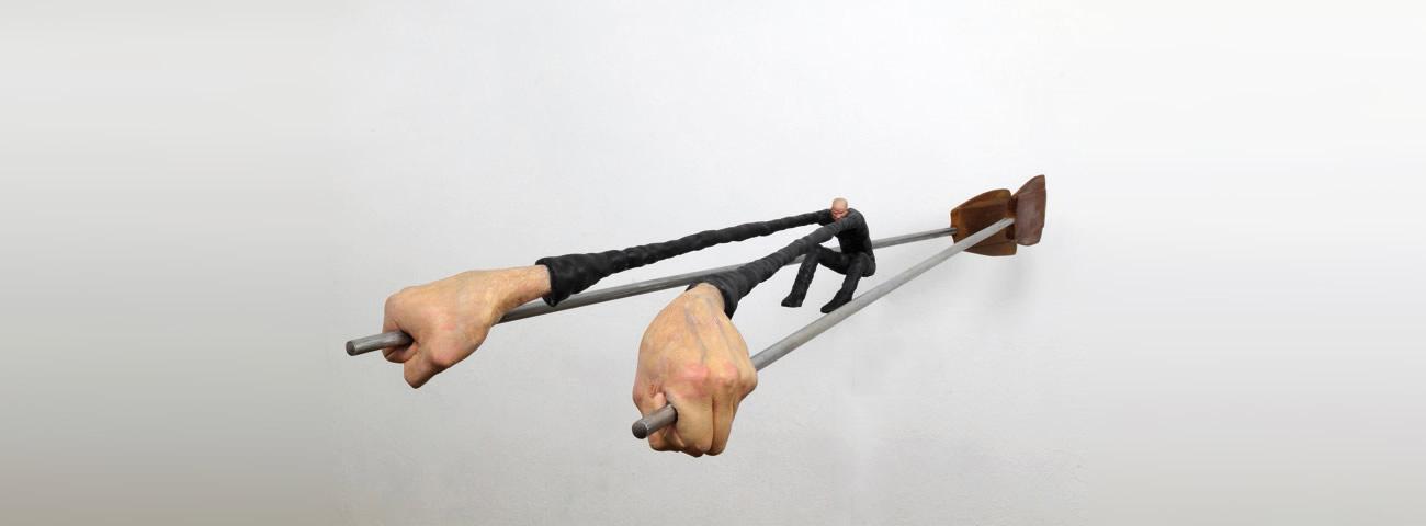man rowing with giant hands by gerardo feldstein