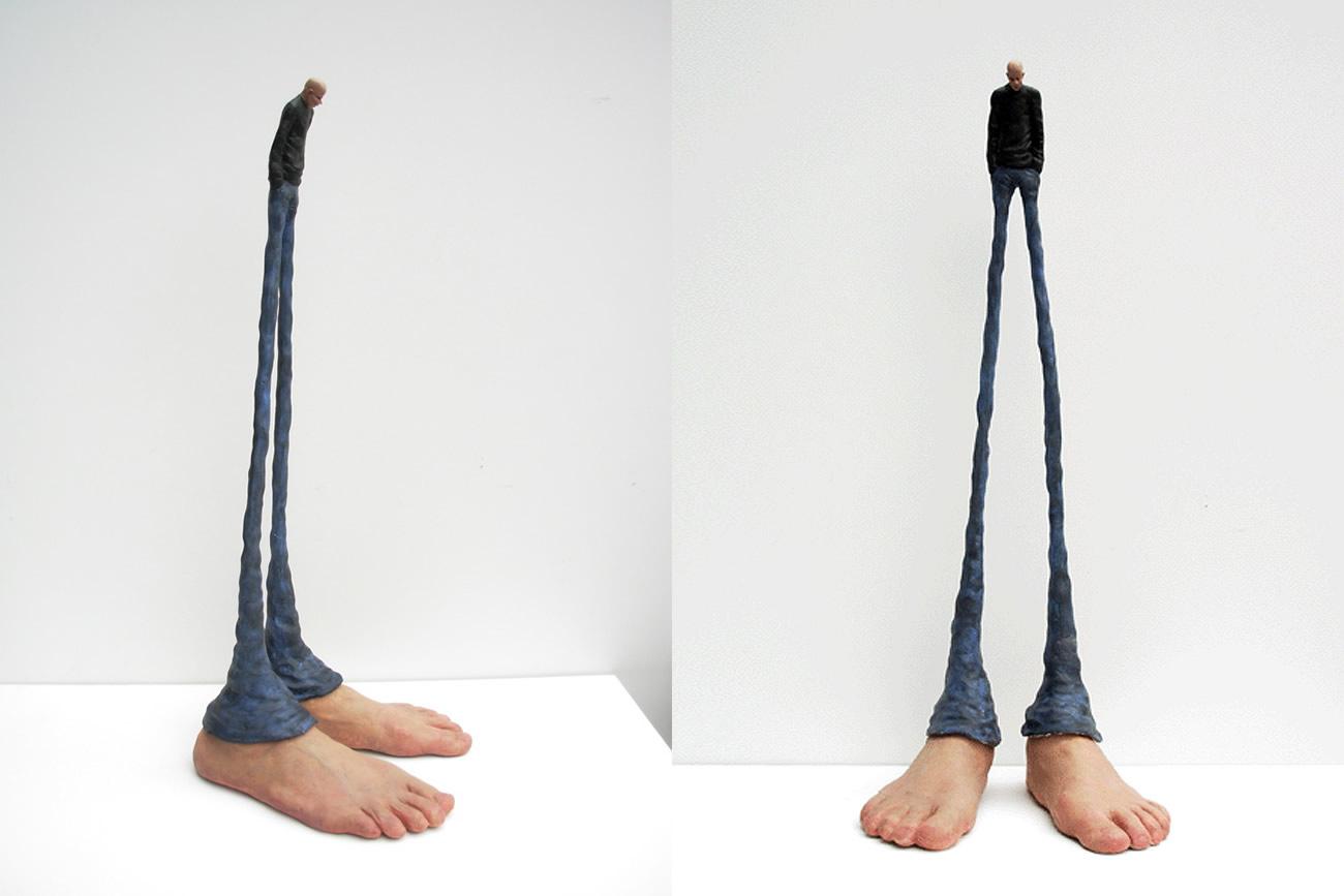 sculpture, man with giant feet by gerardo feldstein
