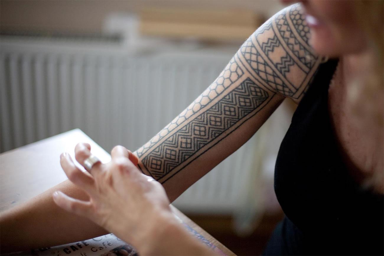 geometric tattoo on arm by Karolina Czaja