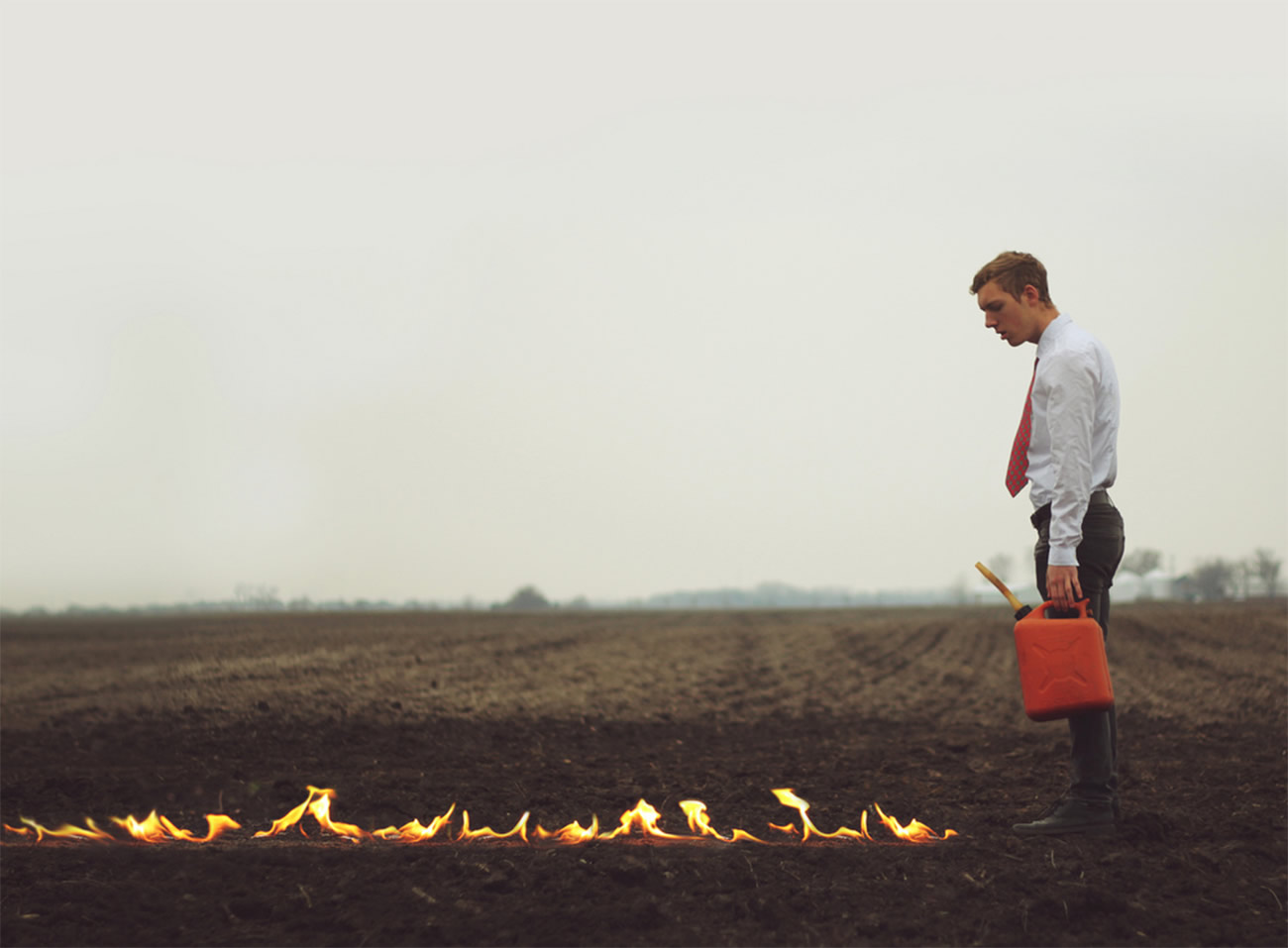 gasoline creates fire line on field. photography by kyle thompson