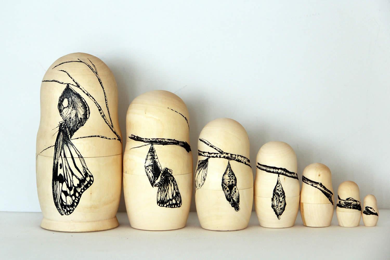 moth birth evolution, matryoshka wood by raul gutierrez