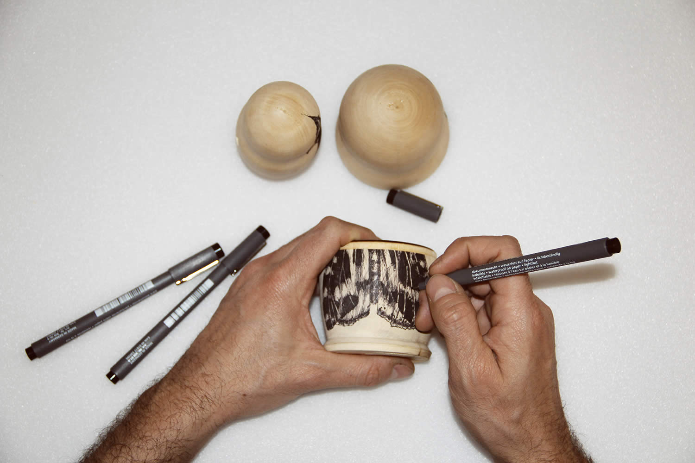 matryoshka wood by raul gutierrez, artist drawing on wood