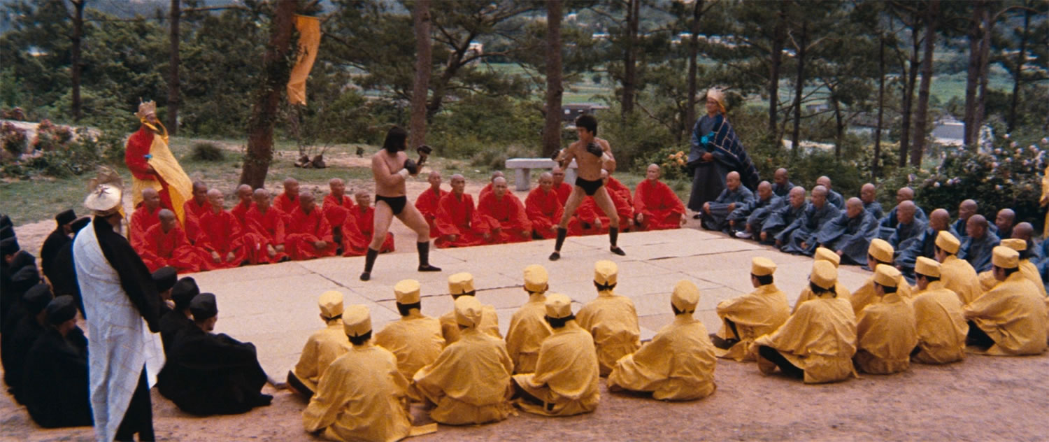 men in colored suits watching a martial arts fight, Enter The Dragon
