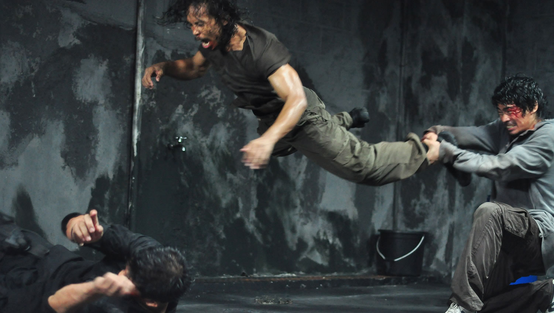 man pulling another's leg, raid movie
