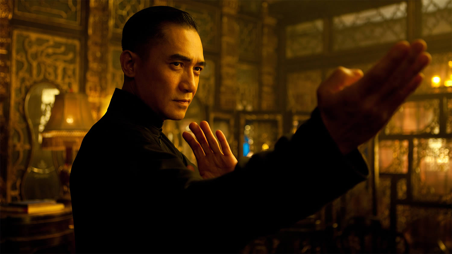 the grandmaster, fire warm scene with man ready to fight