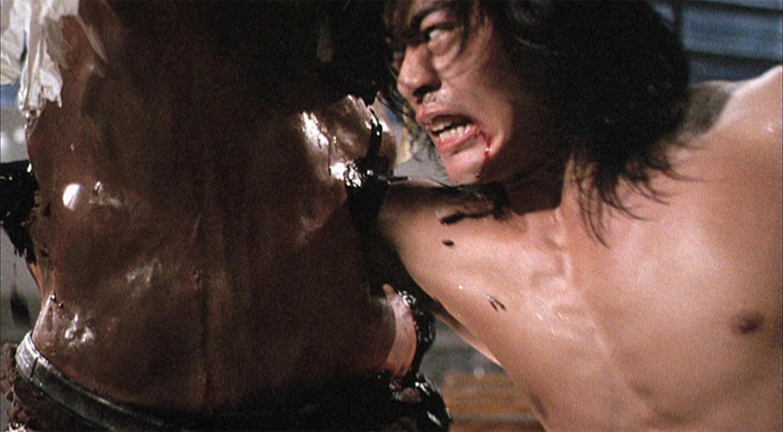 man punches through stomach