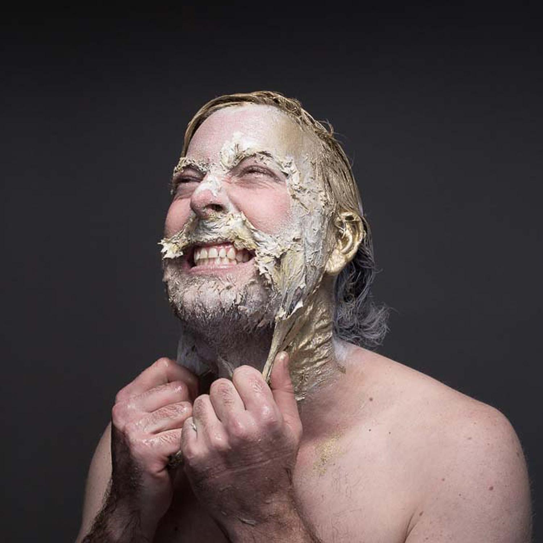 man tearing plastic makeup from face, Haezer Album Art by Chris Slabber