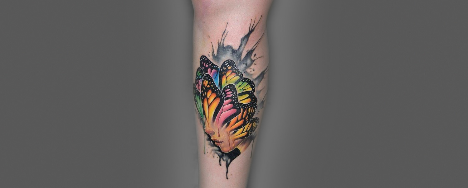 woman with butterfly head tattoo by paul vander johnson