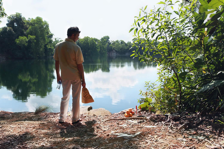 mister john movie, man by lake