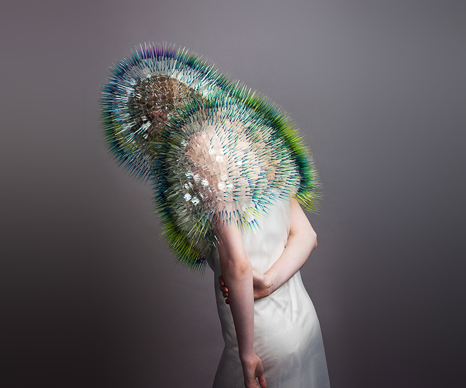 green hat and shoulder garment by maiko takedo