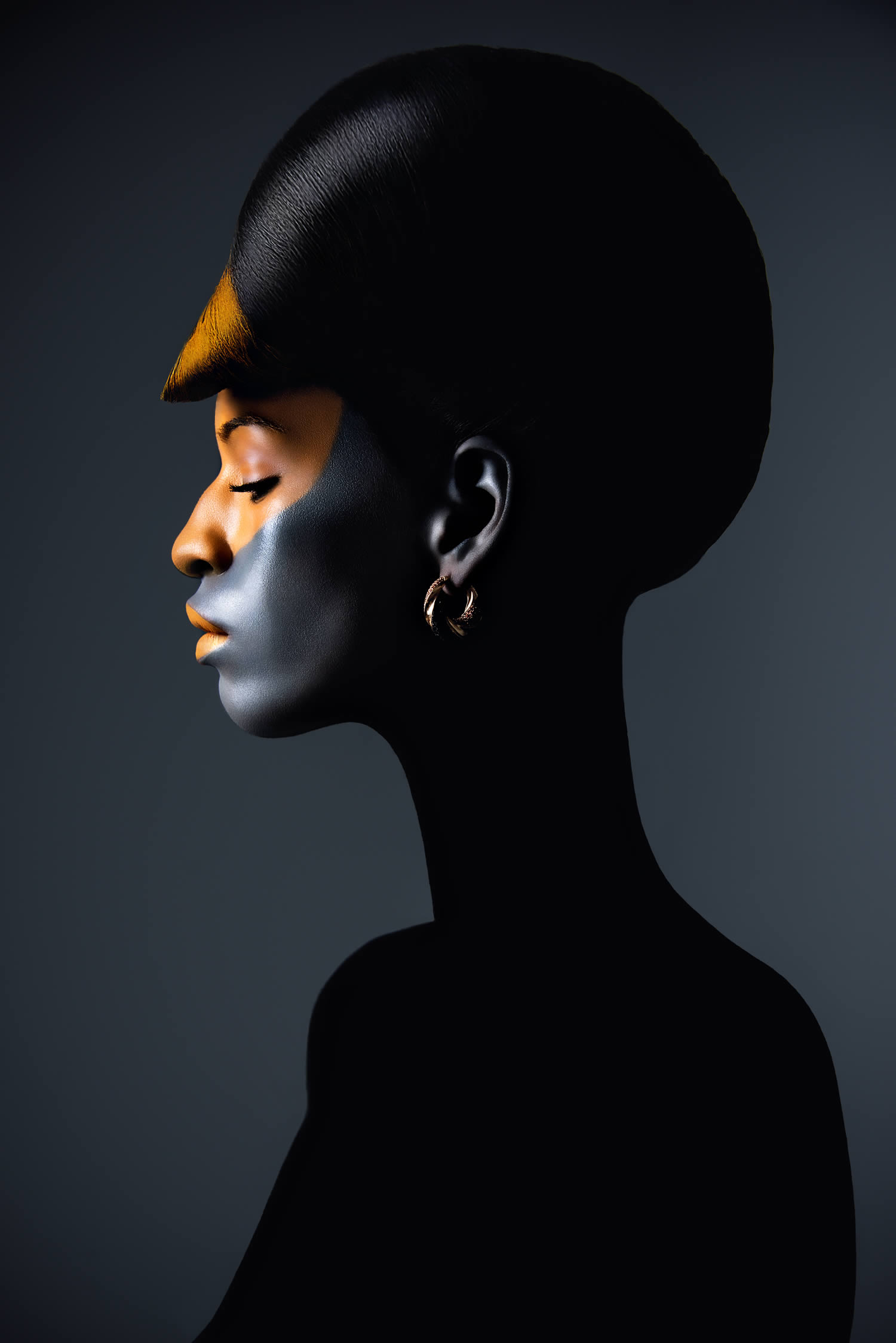 black woman with gold paint on face by Azaryan Veronica