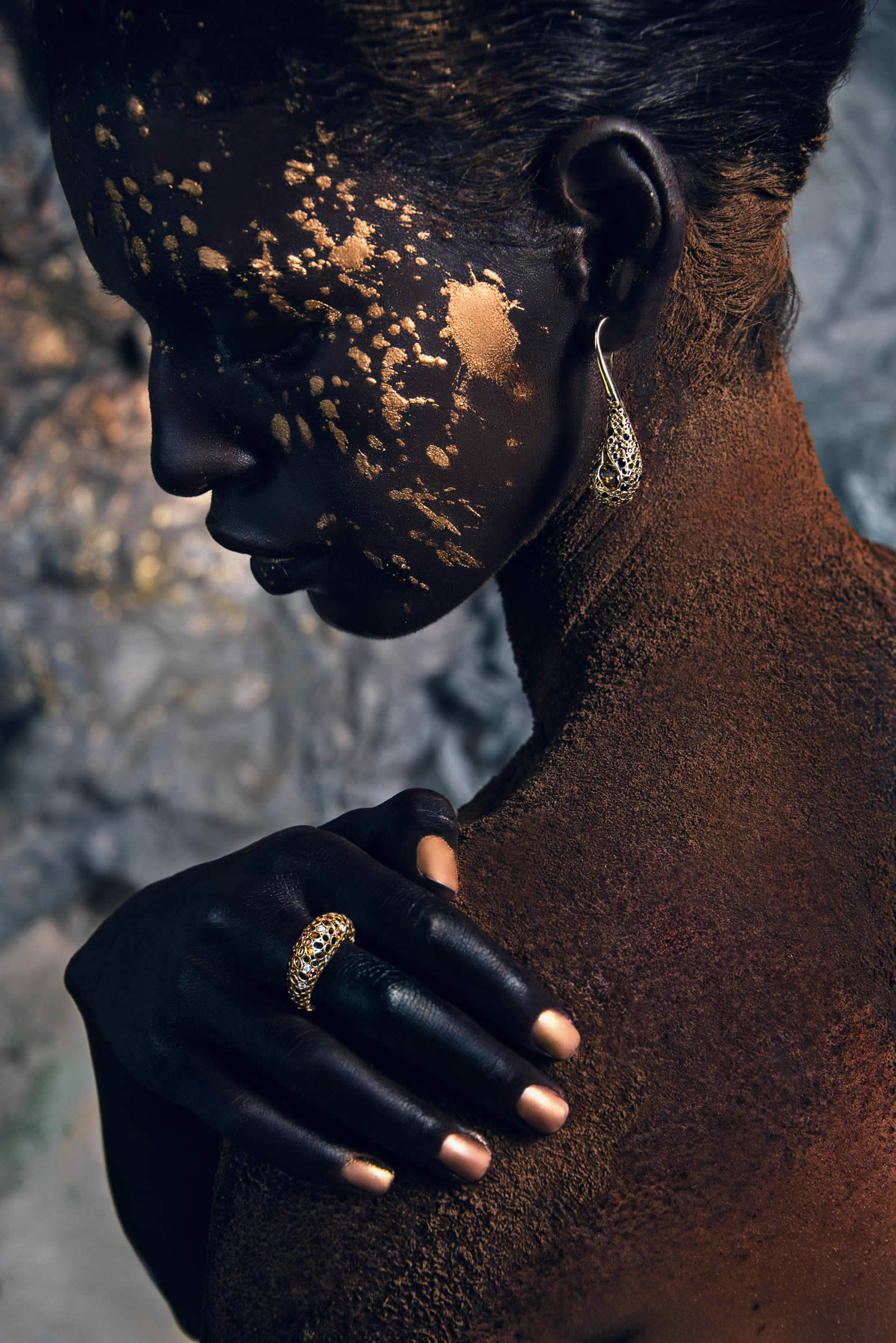 close-up of black woman with gold paint splatter by Azaryan Veronica