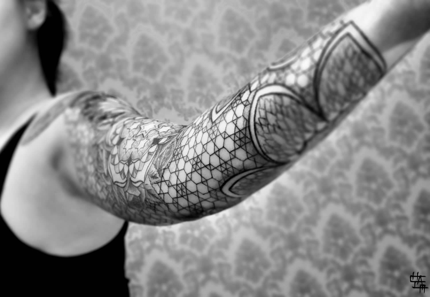 geometric pattern tattoo on arm by chaim machlev