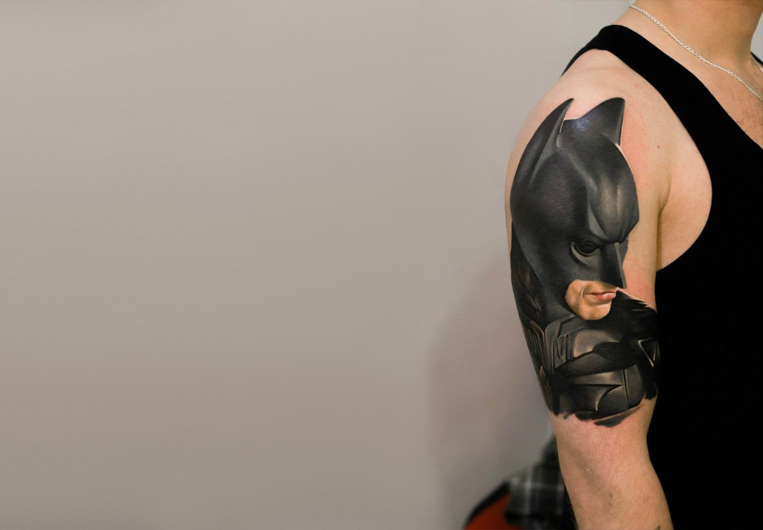 photorealist tattoo of batman on arm by denis sivak