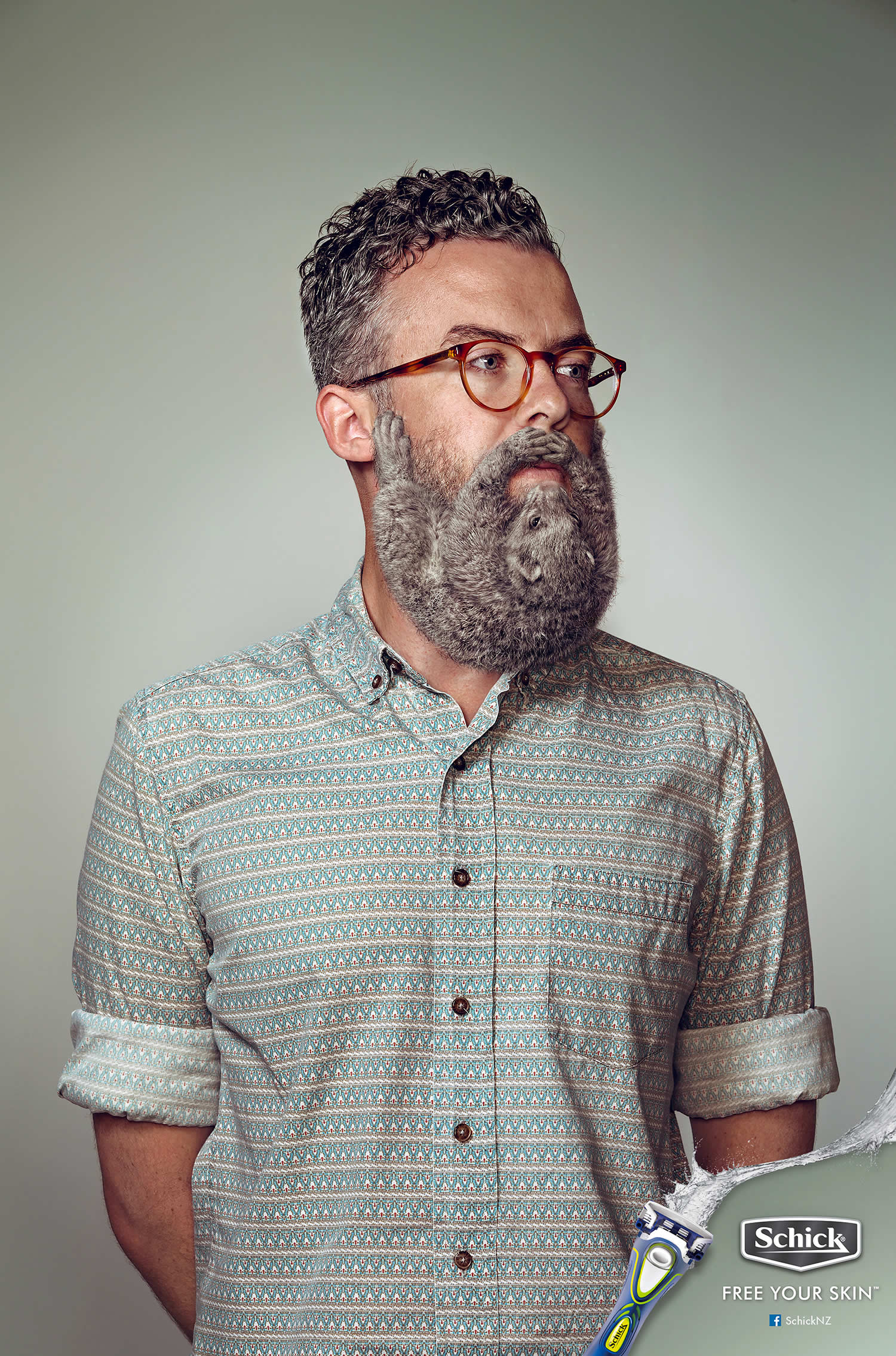 Man with grey beard, Electric Art / Schick NZ. By Sharpe + Associates Inc.