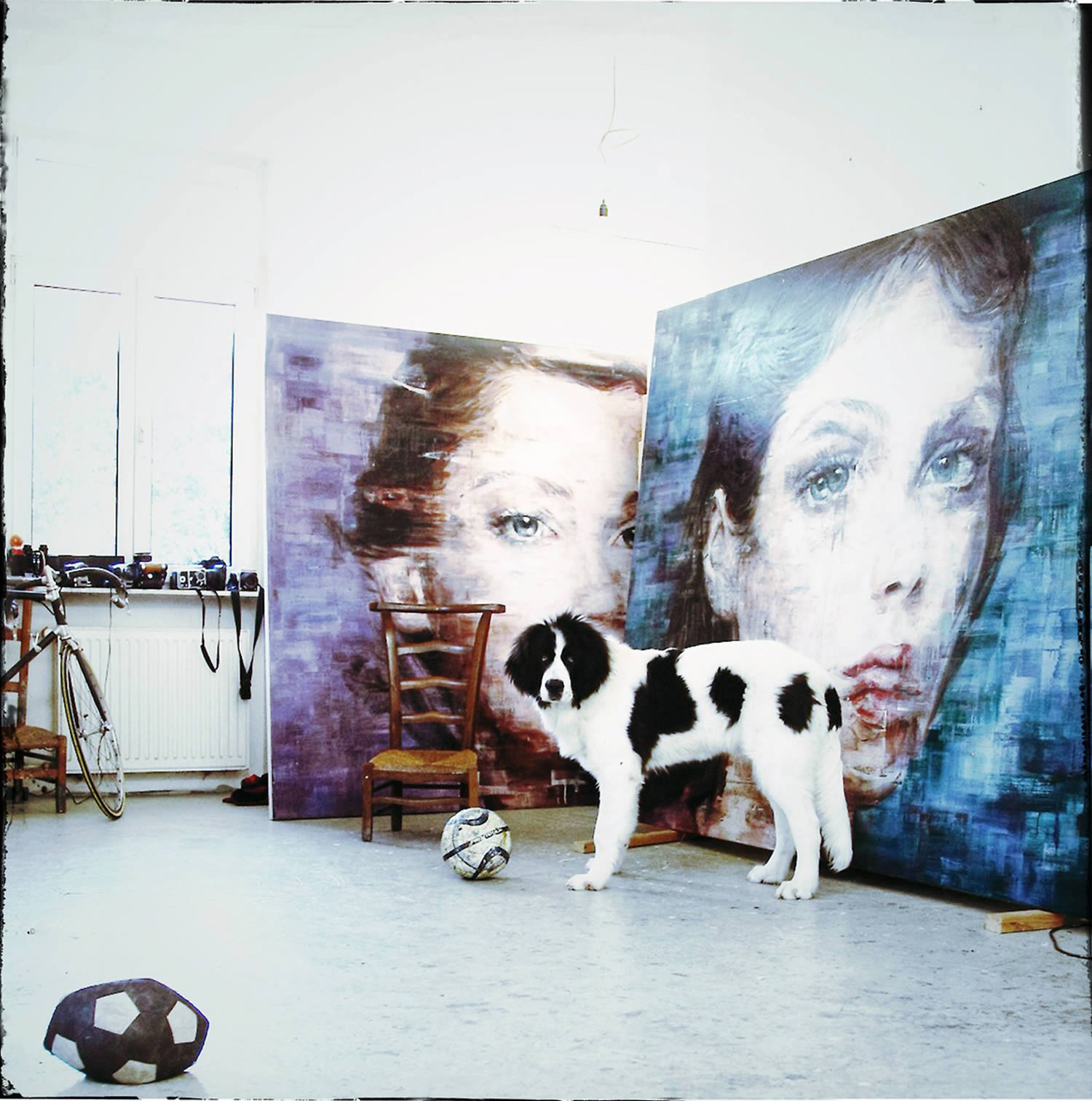 large-scale paintings in studio with artist's dog posing. Harding Meyer