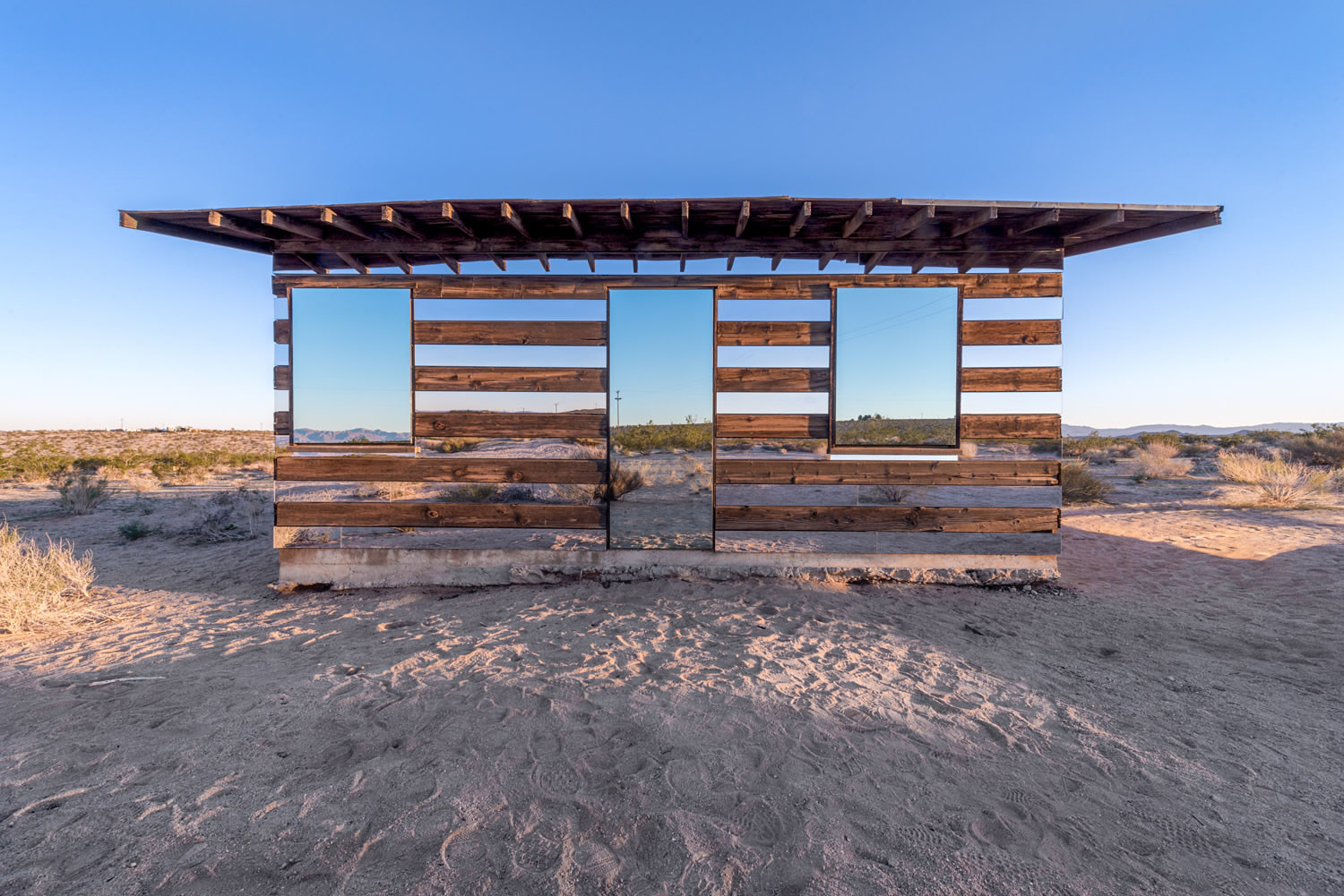 front view of lucid stead shack, mirrored, by phillip k smith