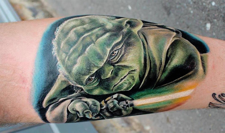 Yoda tattoo with light saber  by Jordan Croke