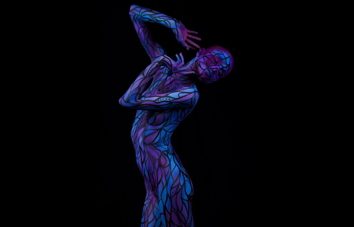purple and blue body painting on woman by trina merry