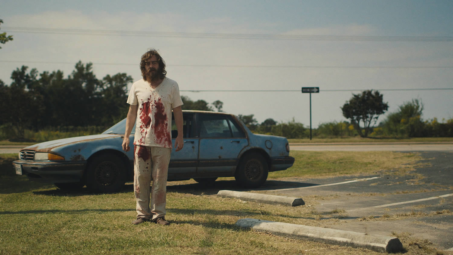 blue ruin actor with blood on shirt