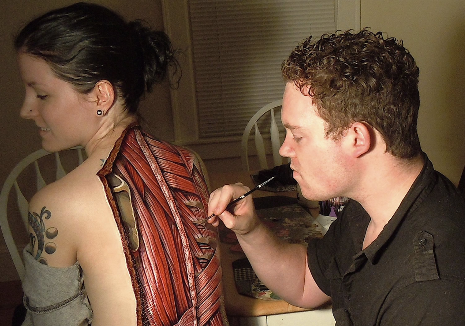 danny quirk painting on woman's back