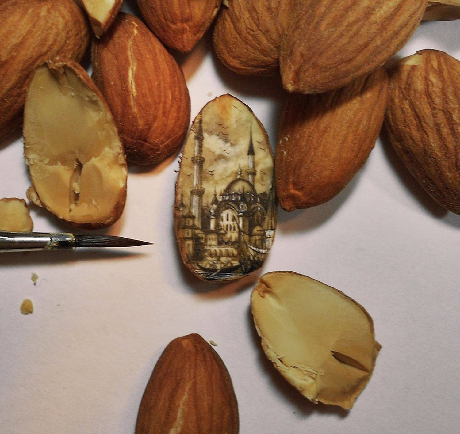 painting on almond by Hasan Kale