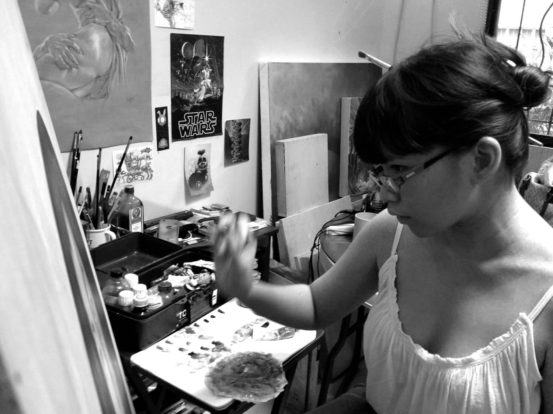 artist mek yambao in her studio, painting