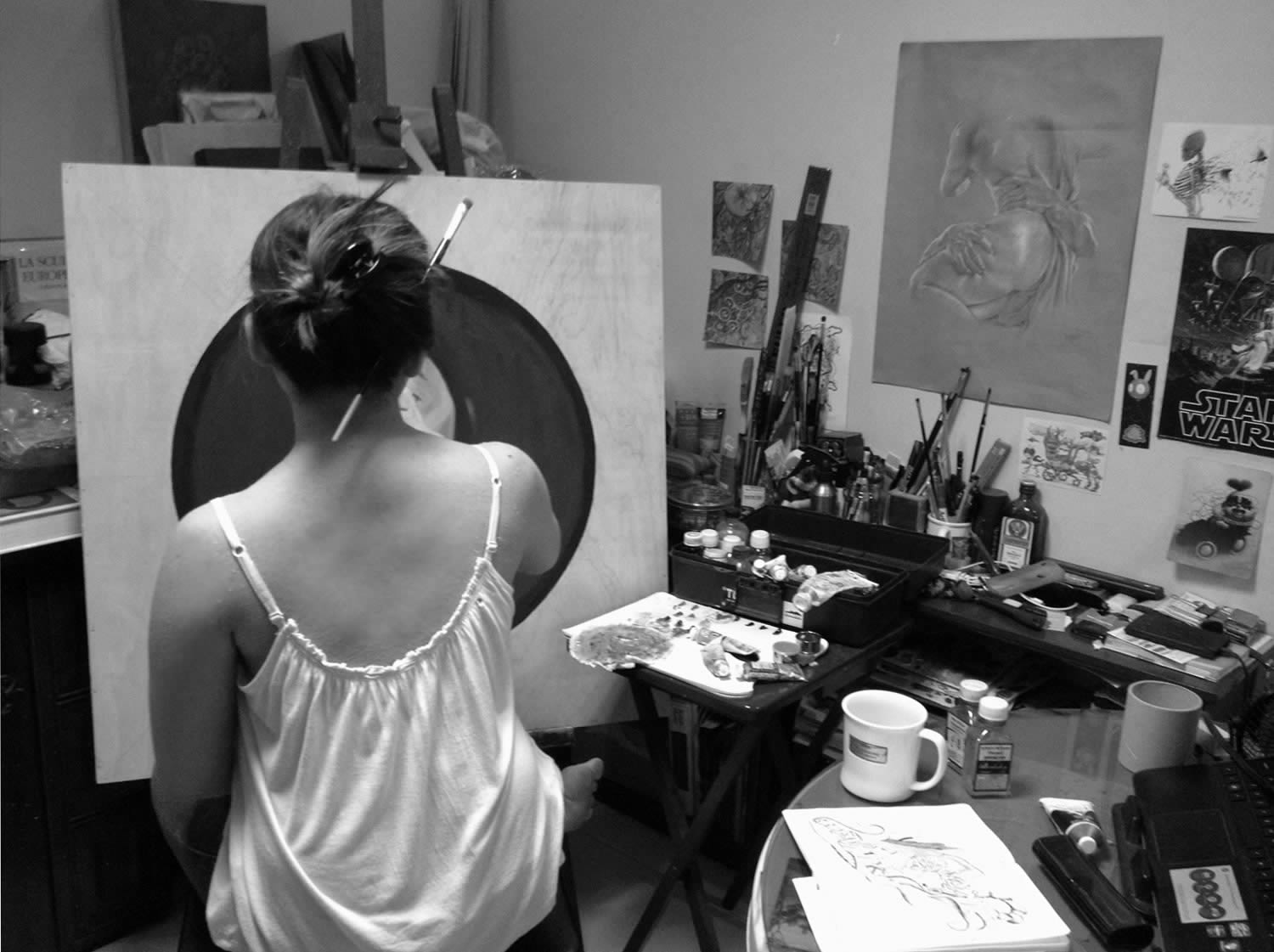 a back shot of artist mek yambao in her studio