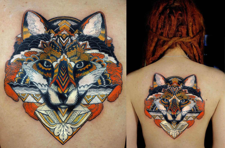 geometric wolf tattoo on back, by Nika Samarina