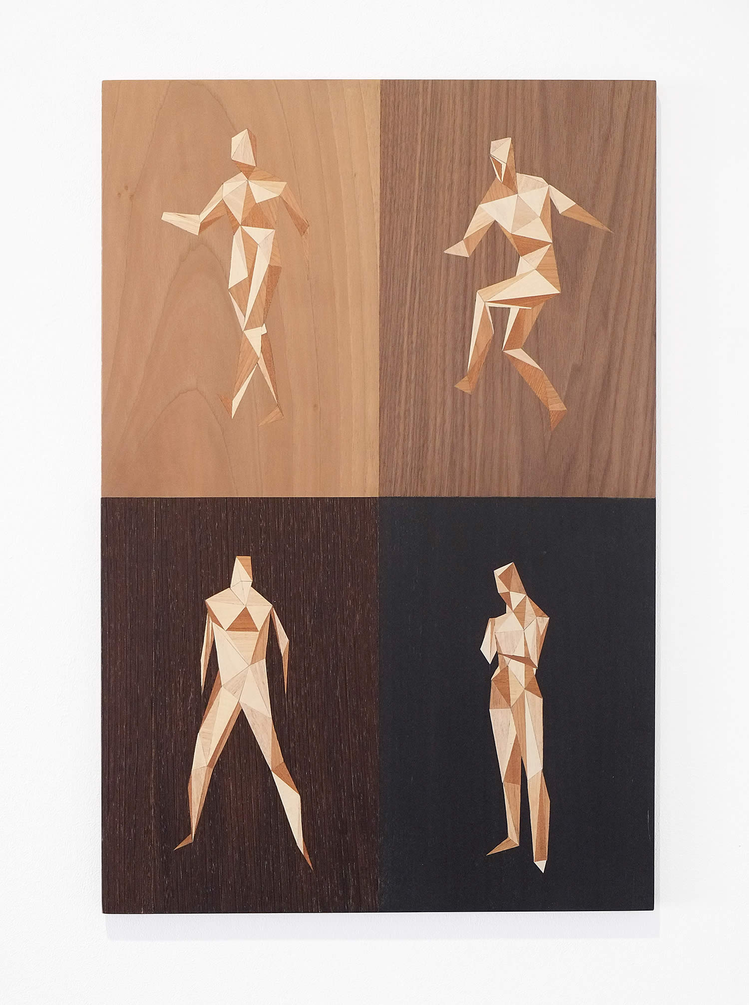 human figures made in wood. quid by rocco pezzella