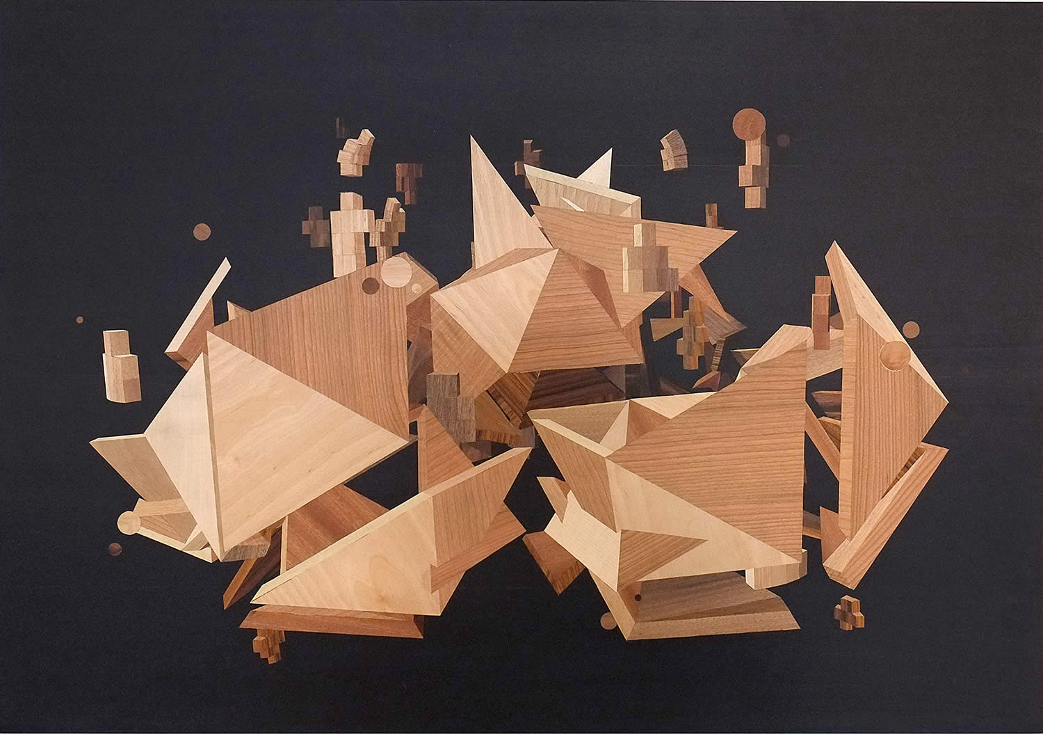 3d geometic shapes in wood. quid by rocco pezzella
