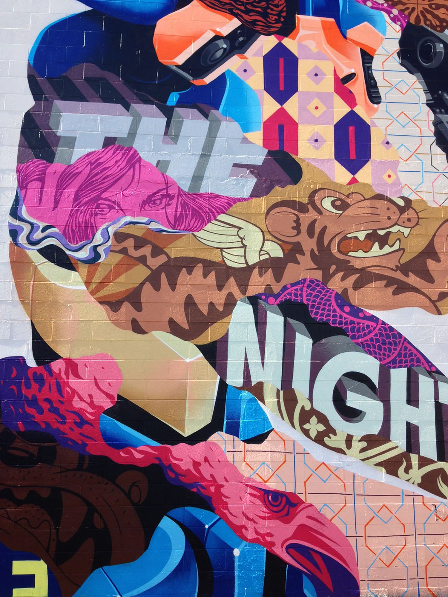 close-up of cartoon graffiti by Tristan Eaton