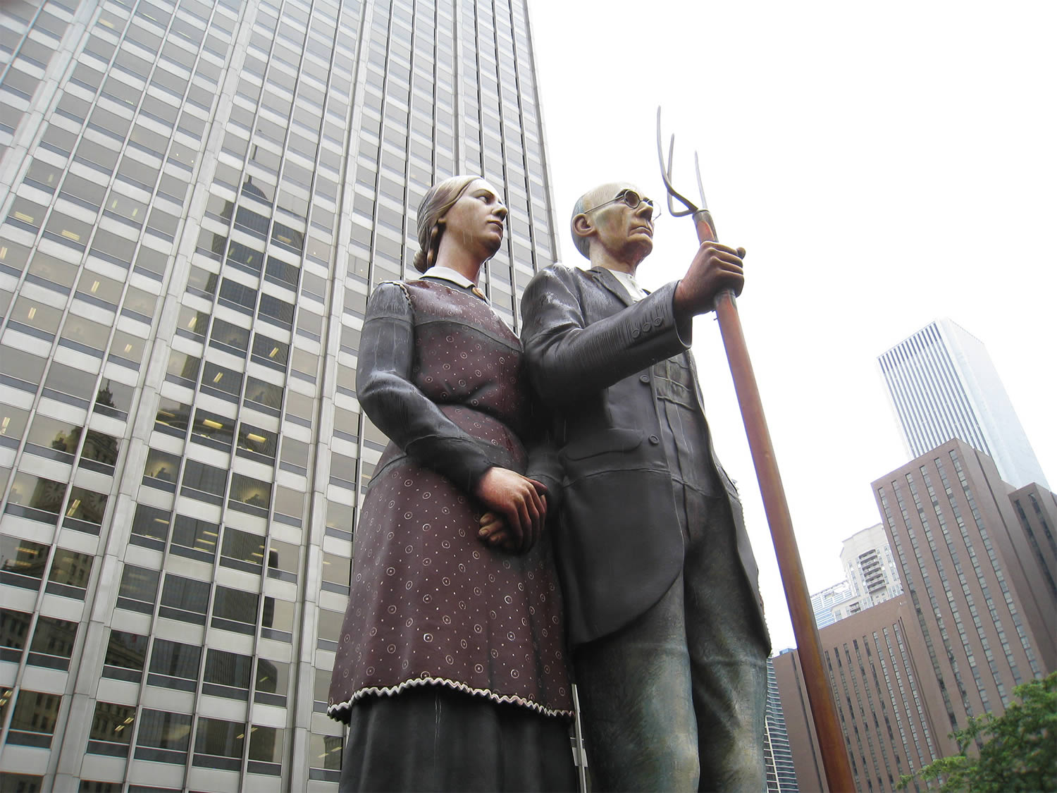 god bless america, couple with skyscrapers in background, by john seward johnson