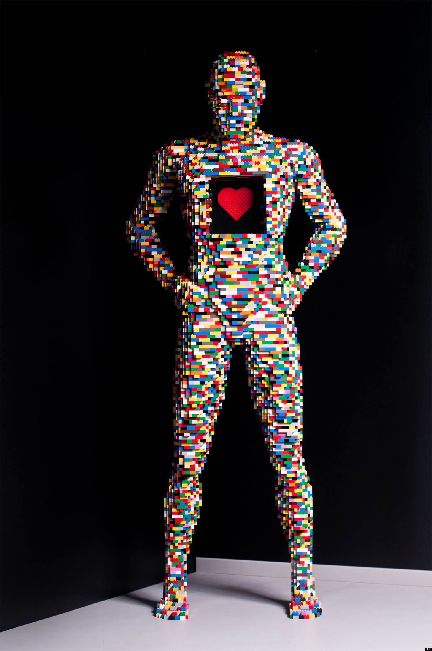 multicolored lego man with heart, by nathan sawaya