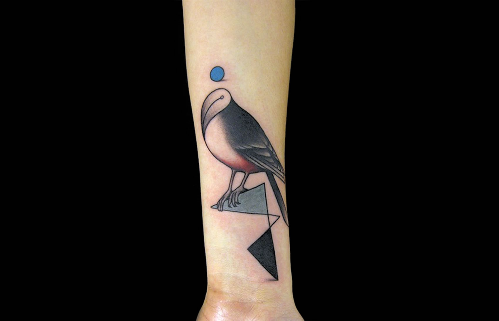 ball and bird without head by nero tattoo