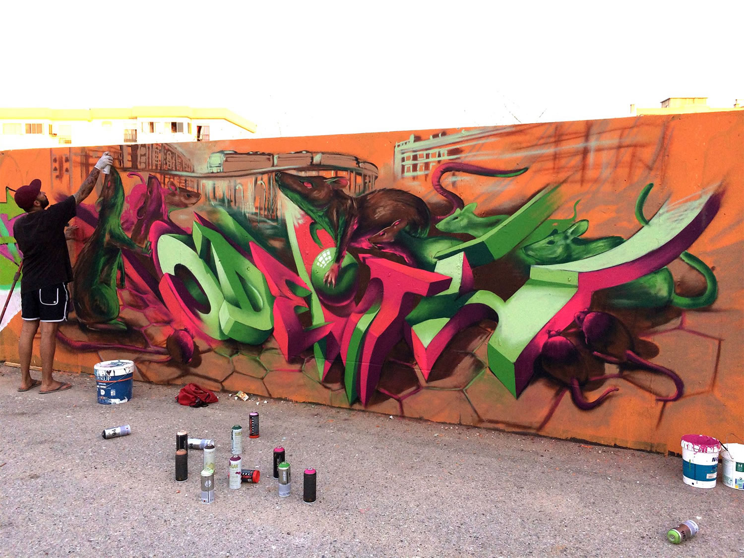 artist odeith working on a mural