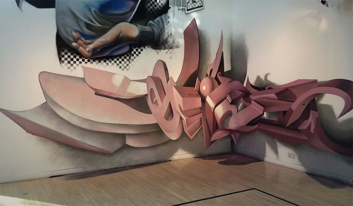 pink 3d letters on indoor wall, graffiti by odeith