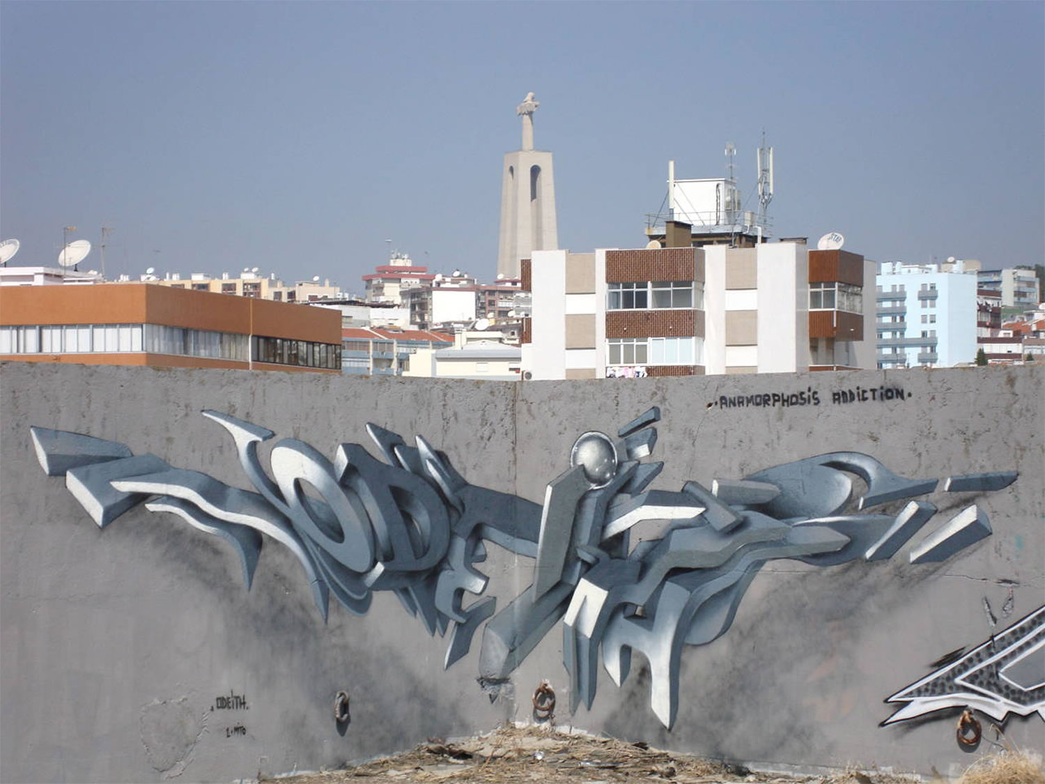 silver 3d lettering on wall, lisbon, by odeith