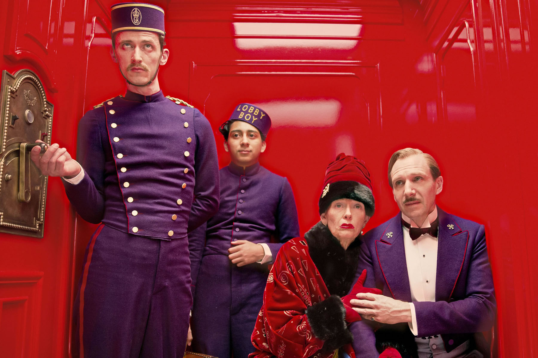 bellboy and passengers in elevator, in The Grand Budapest Hotel